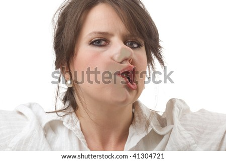 Young woman stopped by an invisible barrier; close-up isolated on a white background. - stock photo