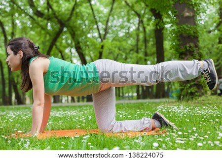 Young Woman Streching in the Park - stock photo