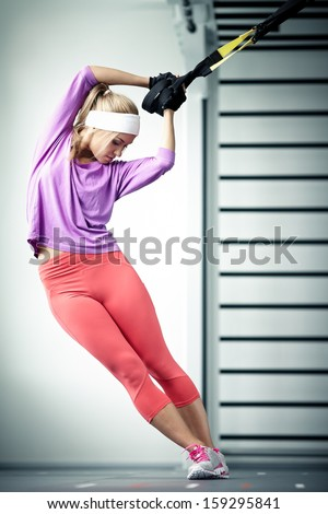 Young woman streching muscles functional training - stock photo