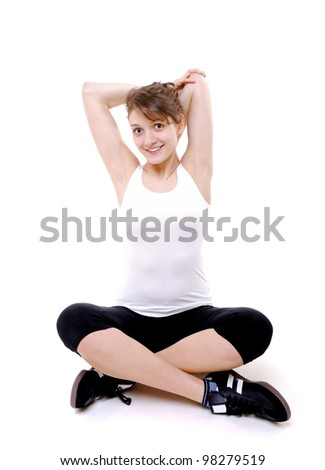 young woman stretches her arms - stock photo
