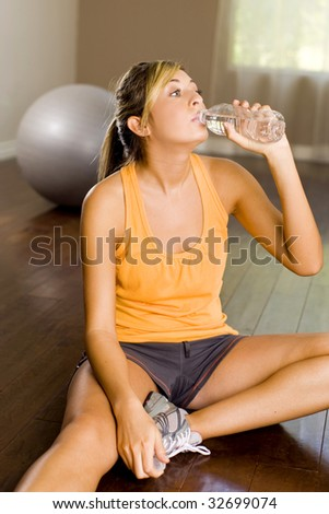 Young woman stretching at a gym