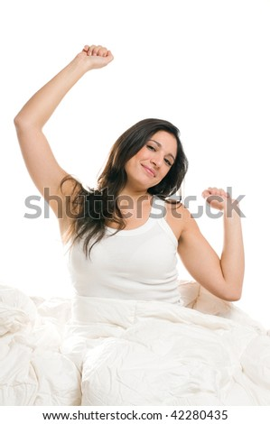 Young woman stretching herself in the morning isolated on white background - stock photo