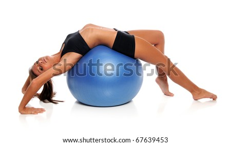 Young woman stretching on fitness ball isolated over white background