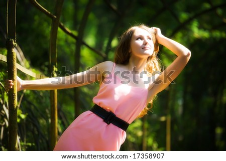 Young woman stretching to the sunlight.
