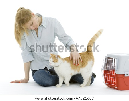 young woman strokes goes out from transporter cat - stock photo
