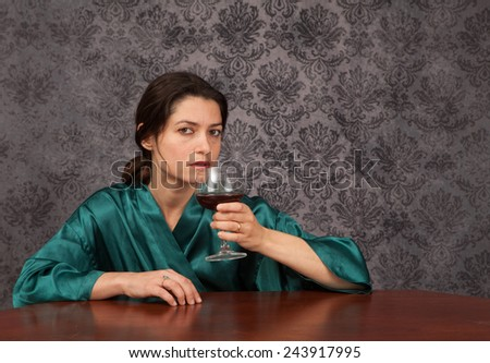 Young woman struggling with alcohol abuse - stock photo
