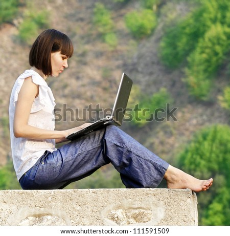 Young woman student learning in the nature - stock photo
