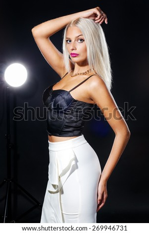 Young woman studio fashion portrait. - stock photo