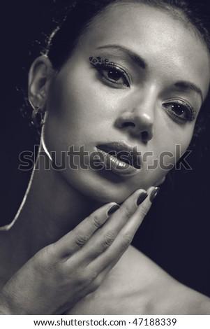 Young woman studio fashion portrait. Dark tinted colors. - stock photo