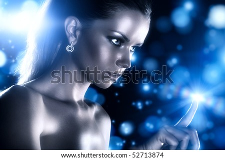Young woman studio fashion portrait with blue stars. - stock photo