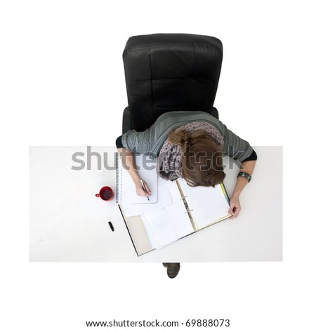 Young woman studying for her exams, seen from above - stock photo
