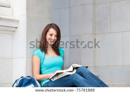 Young woman studying on campus - stock photo