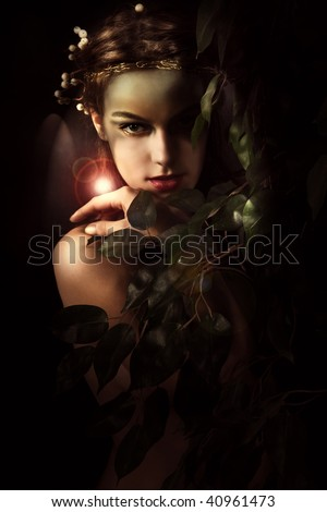 young woman styled as a forest nymph, studio shot - stock photo