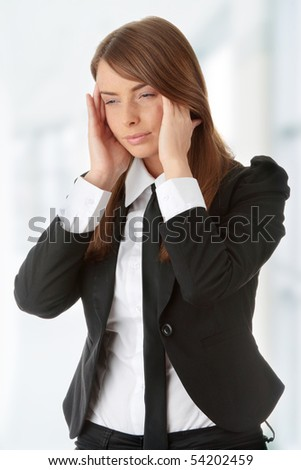 Young woman suffering a headache - stock photo