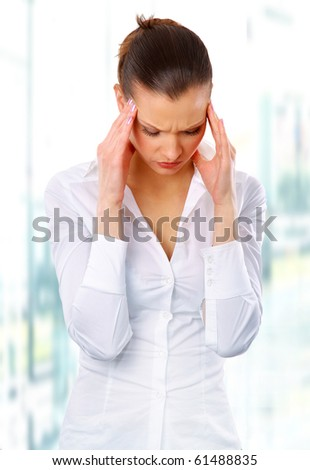 Young woman suffering a headache over white background