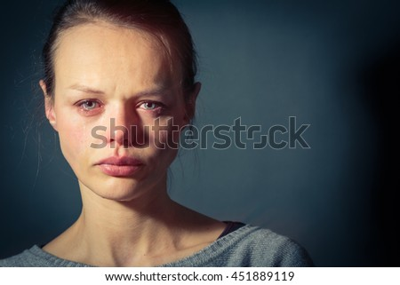 Young woman suffering from severe depression/anxiety/sadness - stock photo