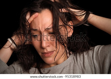 young woman suffers from a splitting headache - stock photo