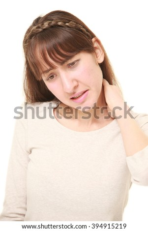 young woman suffers from stiff neck