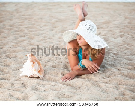 Young woman sunbathing on the tropical beach - stock photo