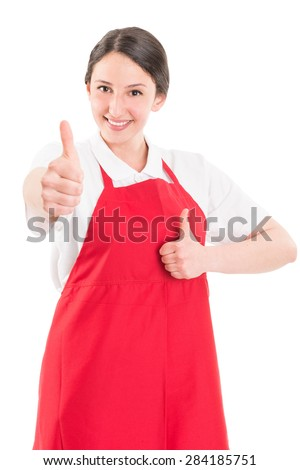Young woman supermarket employee showing thumbs up or like gesture