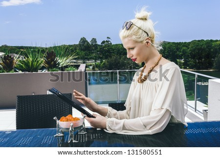 Young woman surfing the net on tablet pc - stock photo