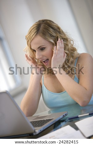 Young woman surprised - stock photo