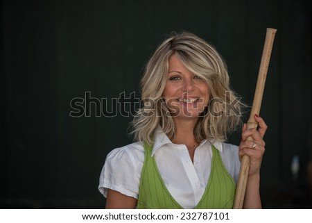 Young woman sweeping outside the shop - stock photo