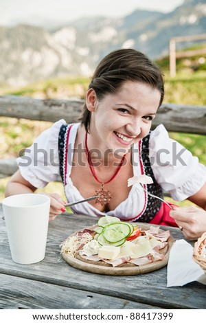 Young woman take a lunch in the alps