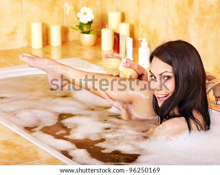 Young woman take bubble  bath. - stock photo