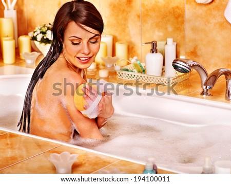 Young woman take bubble bath in bathroom. - stock photo