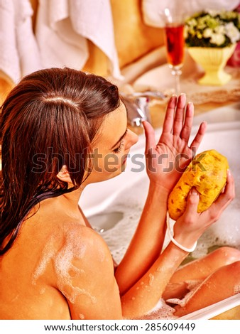 Young woman take bubble bath in home bathroom. - stock photo