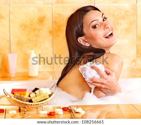 Young woman take bubble  bath. Skincare. - stock photo