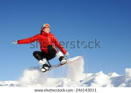 Young woman take fun on the snowboard - stock photo