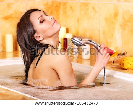 Young woman take shower in bathroom. - stock photo