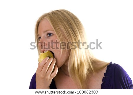 Young woman taking a bite of an apple