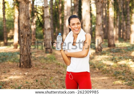 Young woman taking a break after running - stock photo