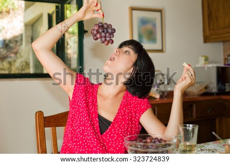 Young woman taking a breakfast at home - stock photo
