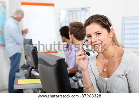 Young woman taking a business call on a headset