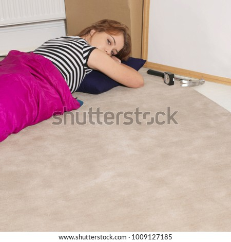 Young woman taking a rest from DIY