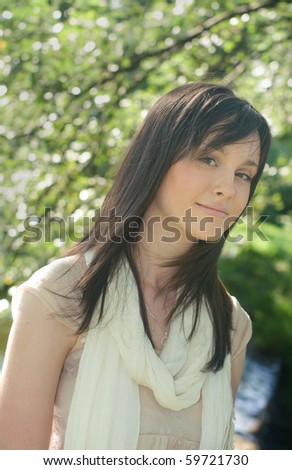 Young woman taking a walk in the park on a sunny day