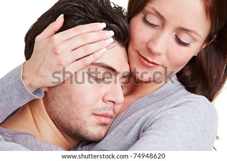 Young woman taking care of her boyfriend while embracing him - stock photo