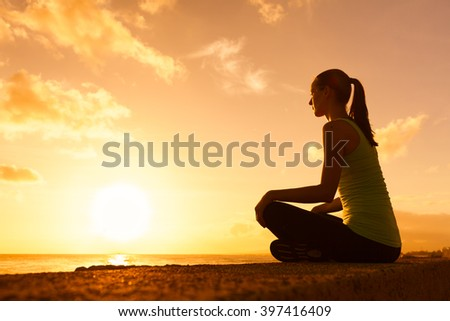 Young woman taking in the beautiful view. - stock photo