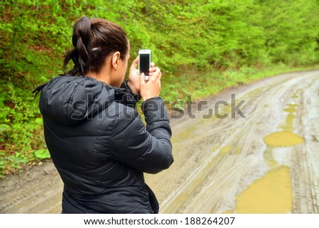 young woman taking photos with a mobile phone