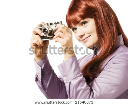 Young woman taking picture with a retro camera - stock photo