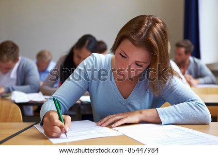 Young woman taking test in job assessment center - stock photo