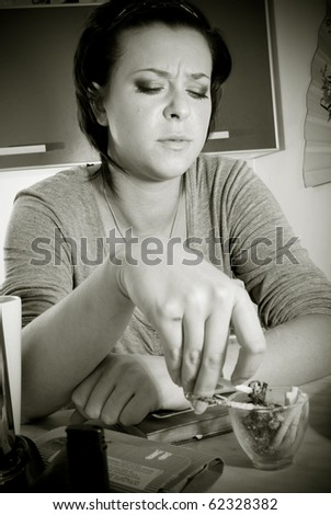 Young woman talking about something at her kitchen