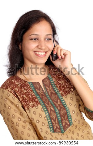 Young woman talking on cellphone - stock photo