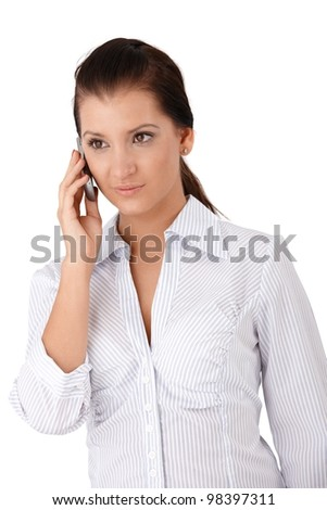 Young woman talking on mobile phone. - stock photo