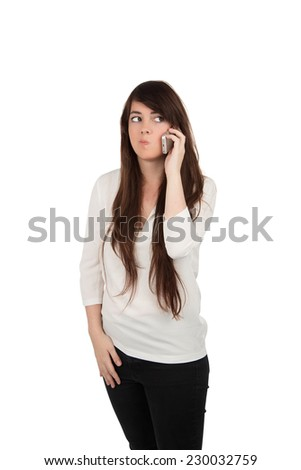 young woman talking on mobile phone against a white background - stock photo