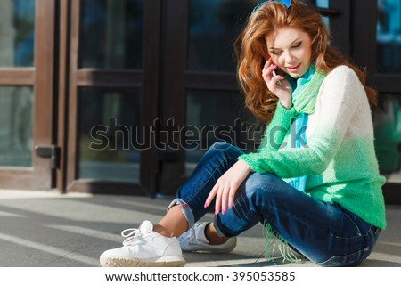 Young woman talking on mobile phone. Young beautiful smiling woman talking on cell phone. Lady talking on the mobile phone  - stock photo